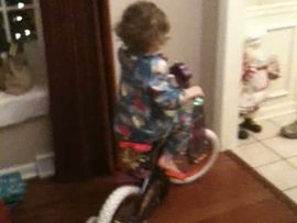 Caileigh riding her bike on Christmas !