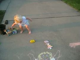 Girls drawing themselves in chalk